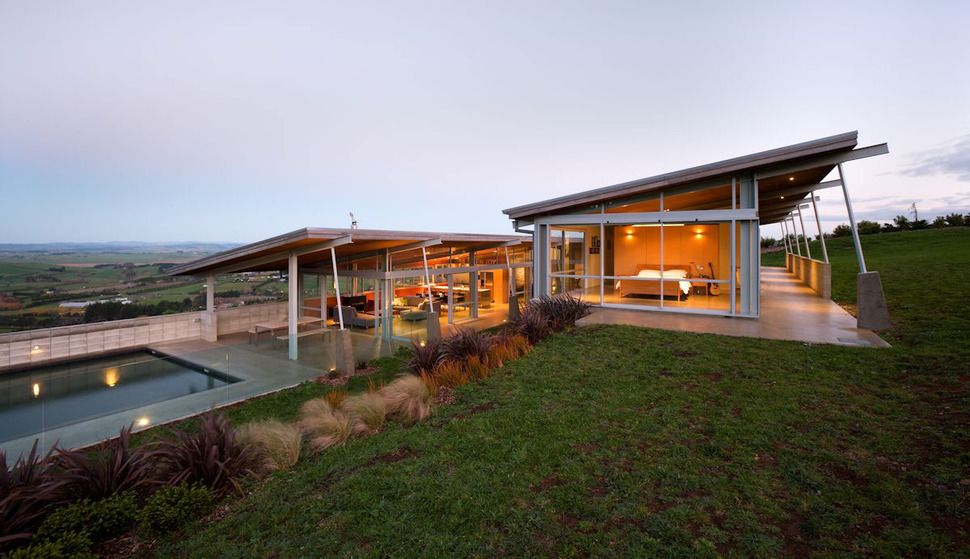 Tiered U Shaped Slope Home features Exposed Steel Elements ...