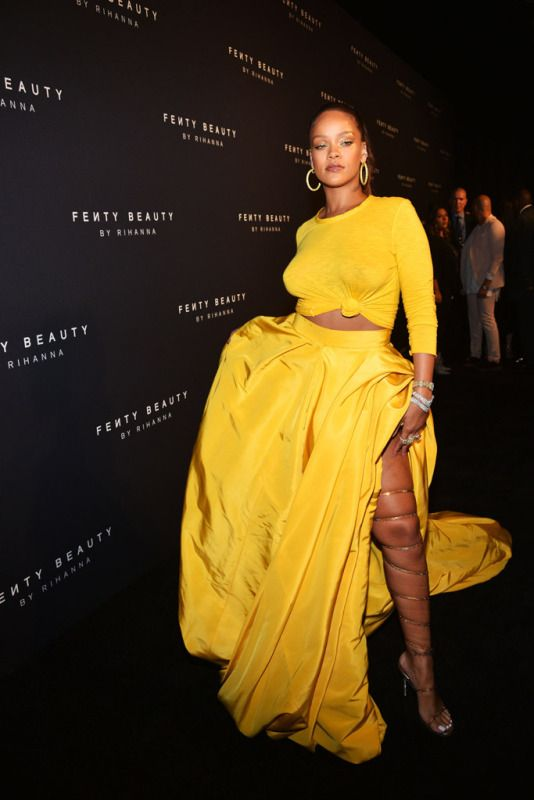 5c4de43112 Rihanna Embraces No Bra Trend in Bold Yellow Outfit at Fenty Beauty ...