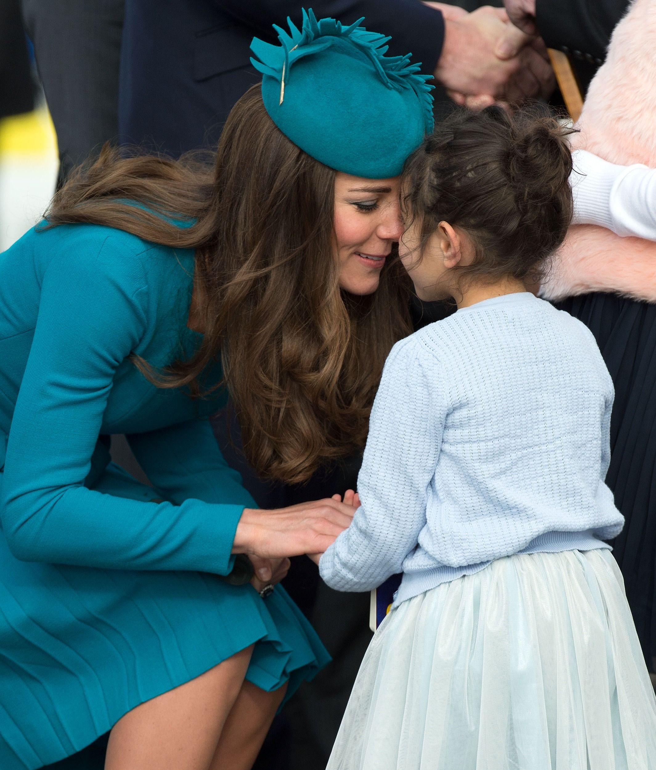 The traditional greeting, nose-to-nose after Kate receives a gift for Prince George. via StyleList