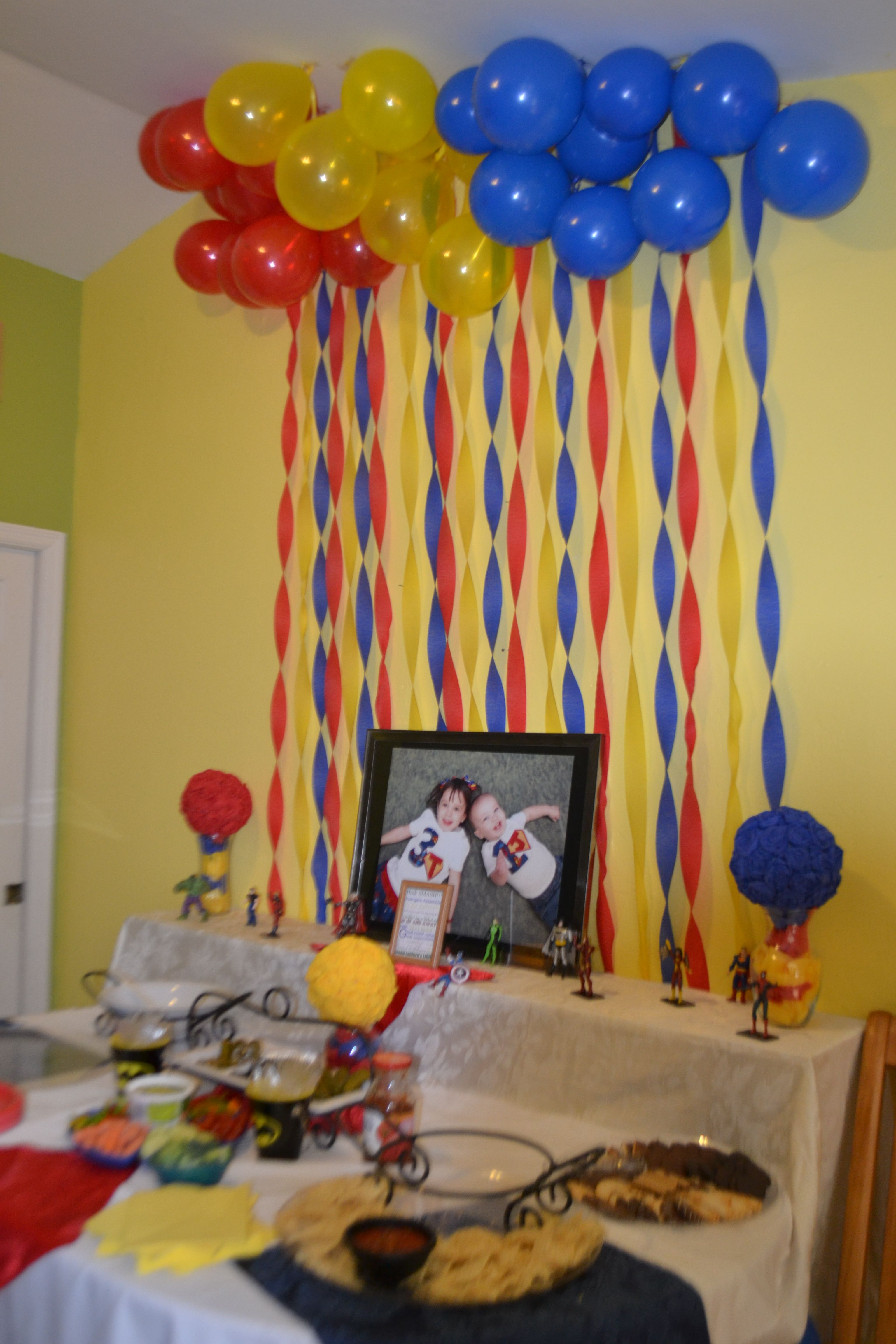 Superhero party food setup and decorations Streamers, balloons ...