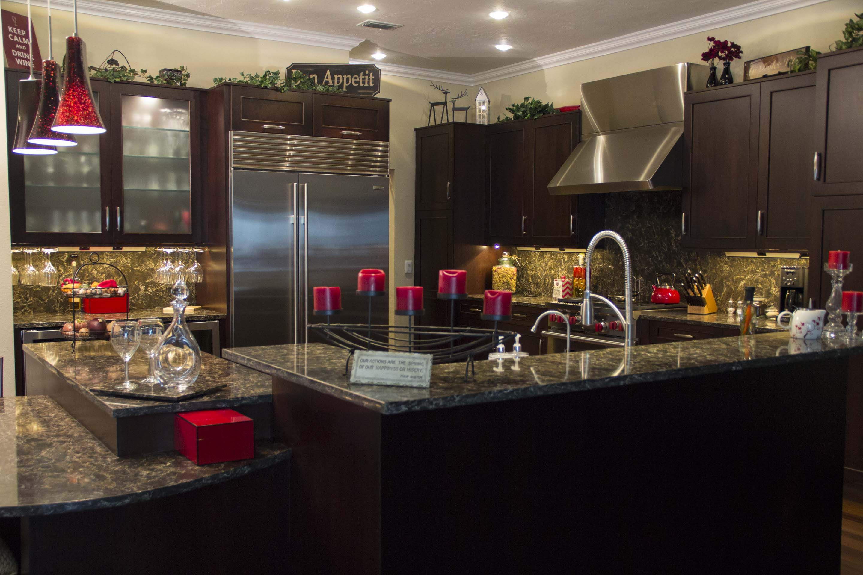 Cherry stained cabinetry nicely accompanied by quartz countertops ...