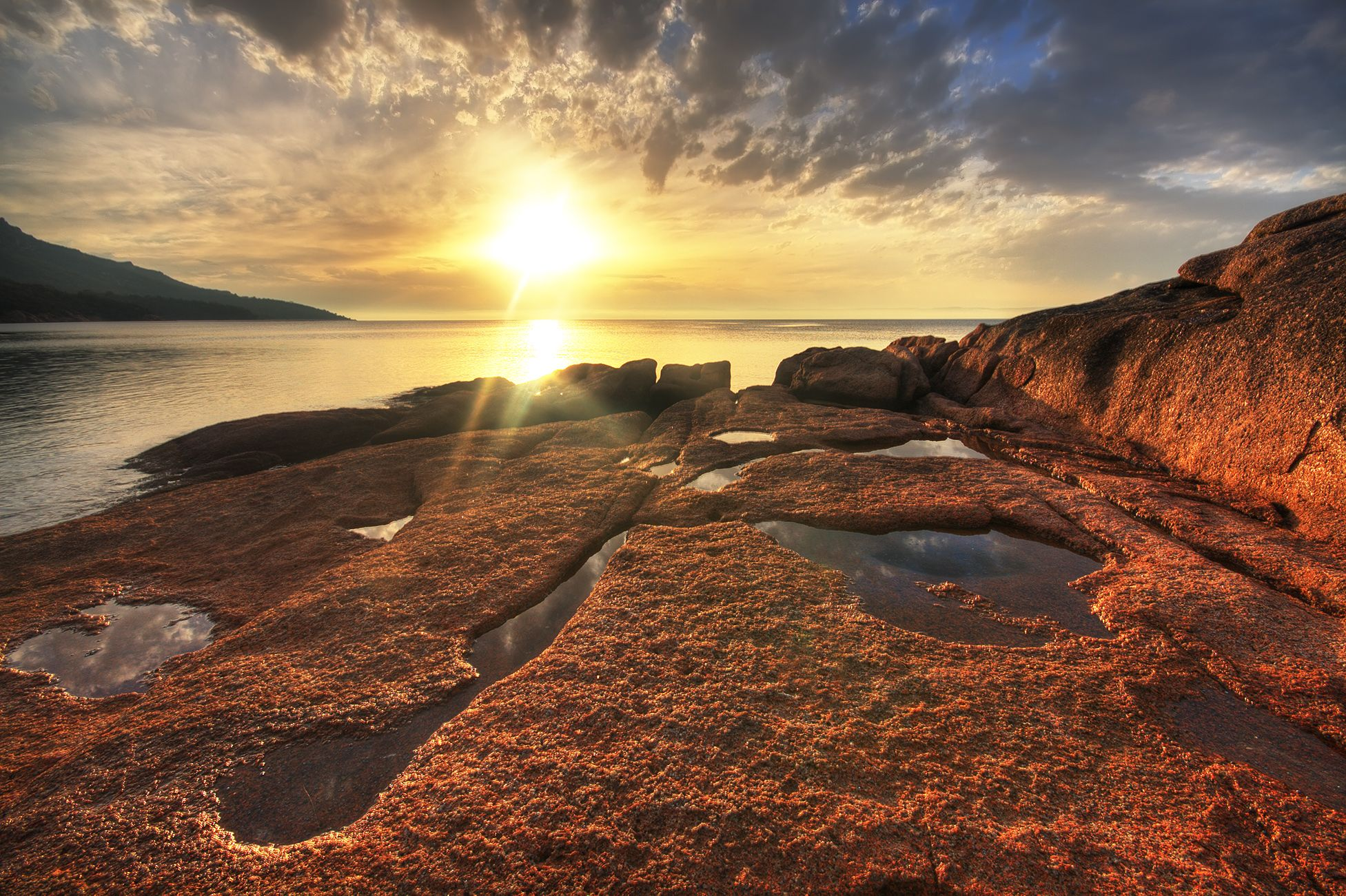 Sunset At Honeymoon Bay Freycinet Peninsula Tasmania Australia - 12 destinations to see the most beautiful sunsets ever