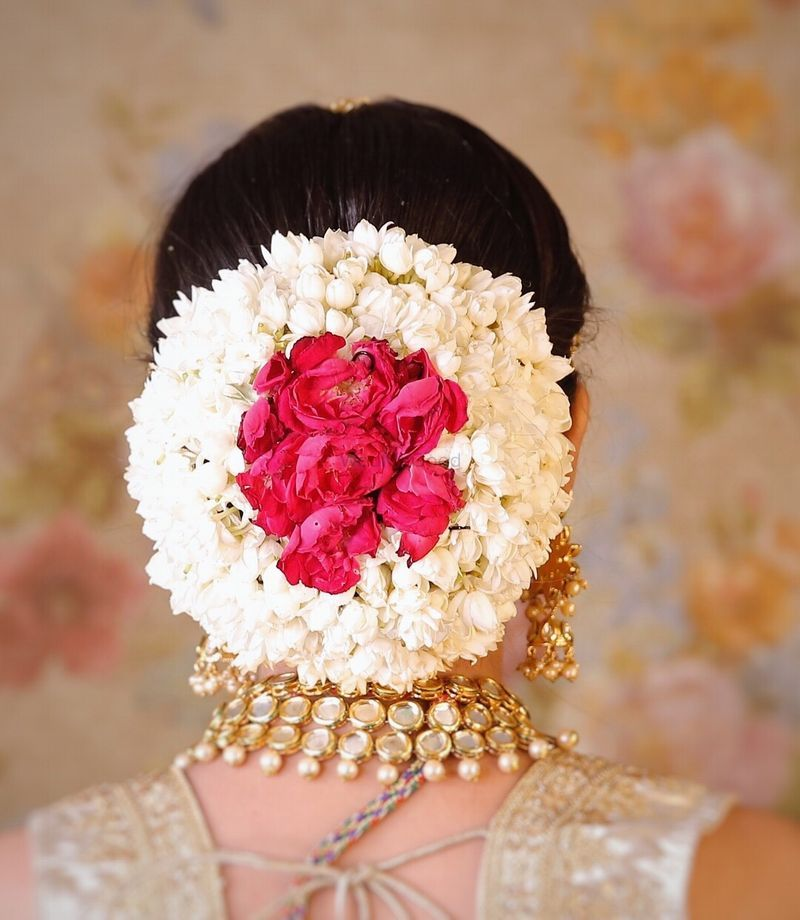 Pretty Floral Bun With Gajra And Pink Roses For An Indian Wedding