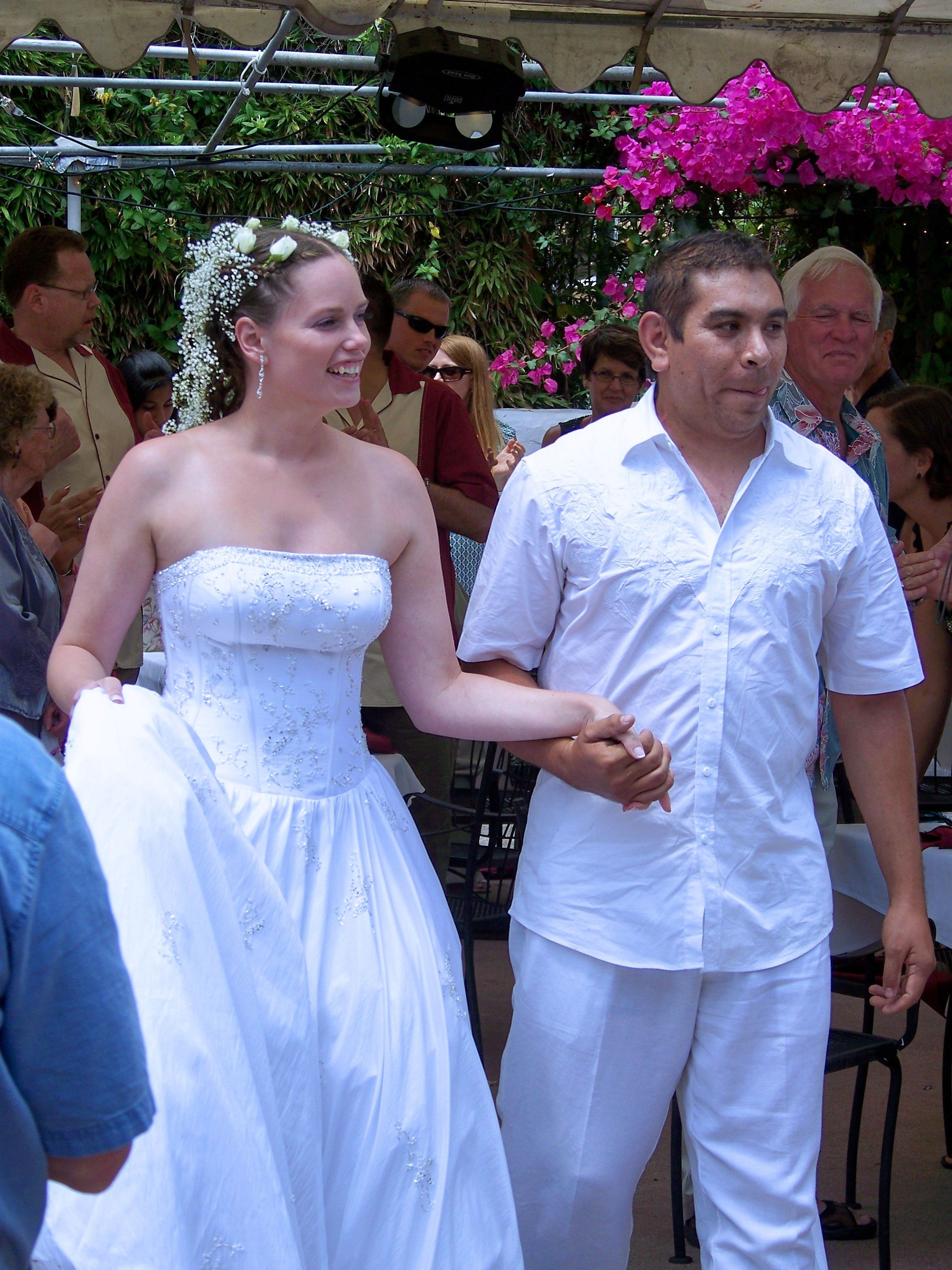 Married couple walking into the reception area.