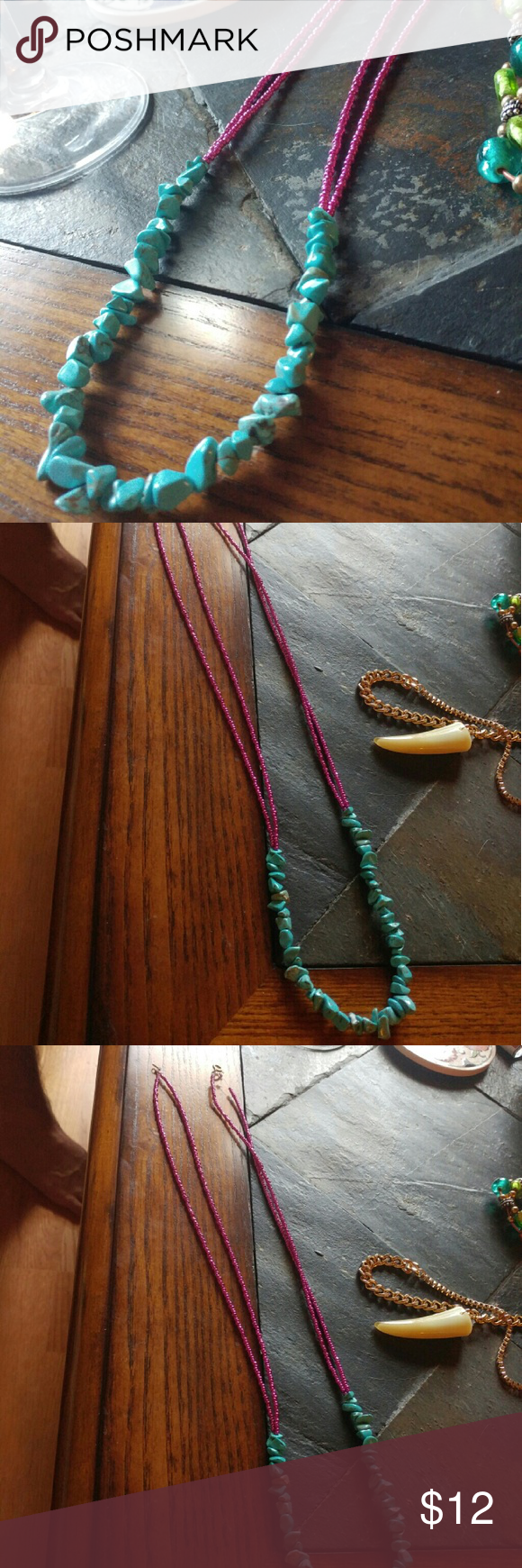 Hand-made Turquoise Necklace Beautiful necklace with turquoise front and center and metallic, magenta beads surrounding. Flexible elastic string with clasp enclosure at back Jewelry