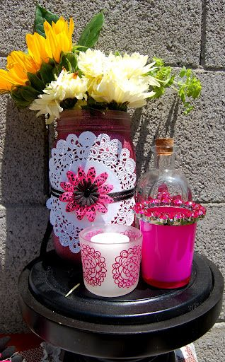 Mason jar centerpieces using mason jars from goodwillofcentralaz mason jar centerpieces using mason jars from glitter spray paint paper doiley silk flower and ribbon all from parent parent lobby mightylinksfo