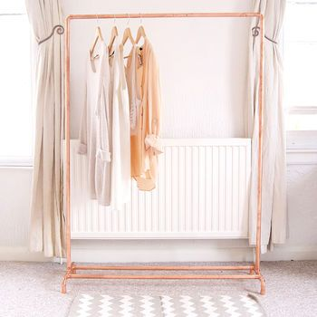 Copper Pipe Clothing Rail is part of Clothes Rack Tumblr - This copper (rose gold colour) clothing rail will complement your home, shop for retail display, or studio Baskets, shoes and other items can be placed along the bottom bars for extra storage or the bottom can be left open to highlight the airy, minimal construction  Each garment rack is made to order from industrial copper pipes and fittings in our Brighton studio by the sea  Once finished your rail will be sanded, polished and sprayed with a strong coating to ensure it keeps its bright copper colour   Posted well protected to ensure it arrives with you safe  Takes seconds to assemble  This rail is very strong but is not indestructible so please don't overload with lots of heavy items Copper  Avoid contact with water  H 145cm W 100cm D 30cm