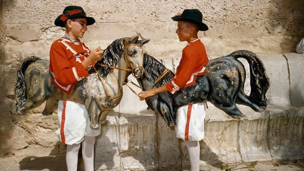 Traditional dances    Two boys prepare for the Cavallets dance, where children traditionally dress up in cardboard horses and dance to flutes, bagpipes and drums. Today, the Cavallets dance typically occurs each August at the Saint Augustine Festival in Felanitx, a municipality in Mallorca's southeast. (Franc and Jean Shor/National Geographic Stock)