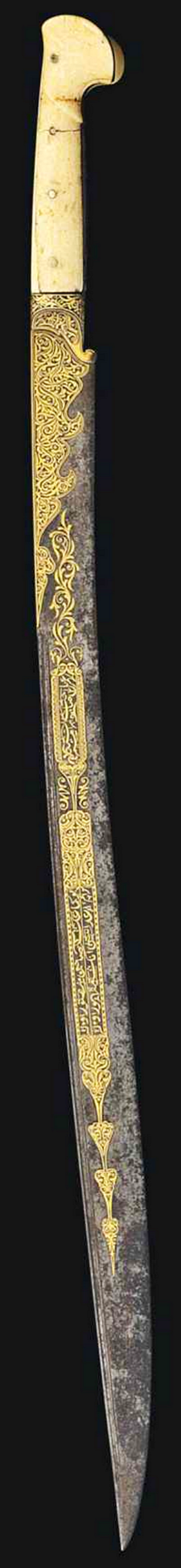 Ottoman yatagan / yataghan, Ah 1241 (1825-26 AD), single-edged slightly curved blade with extensive gold damascening, one side with two calligraphic cartouches, edged with arabesque and issuing tapering palmettes and scrolling vine, the other side with similar cartouches densely filled with scrolling arabesques, cusped cartouche leading to the hilt on each side similarly filled, the spine with date in a cartouche surrounded by scrolling vine, walrus ivory hilt, signed:Ibrahim, 27¼in…