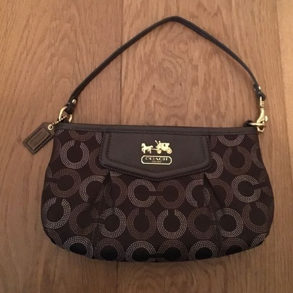 Coach Wristlet Brown Coach wristlet. Never used. Looks brand new. Coach Bags Clutches & Wristlets
