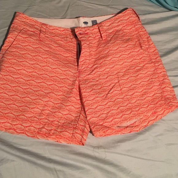 Coral shorts NWOT Cute pair of Old navy shorts that have never been worn! They are a coral color with little fish on them! Bought but were too small so they are still in excellent condition! Asking 20 where they haven't been worn Old Navy Shorts
