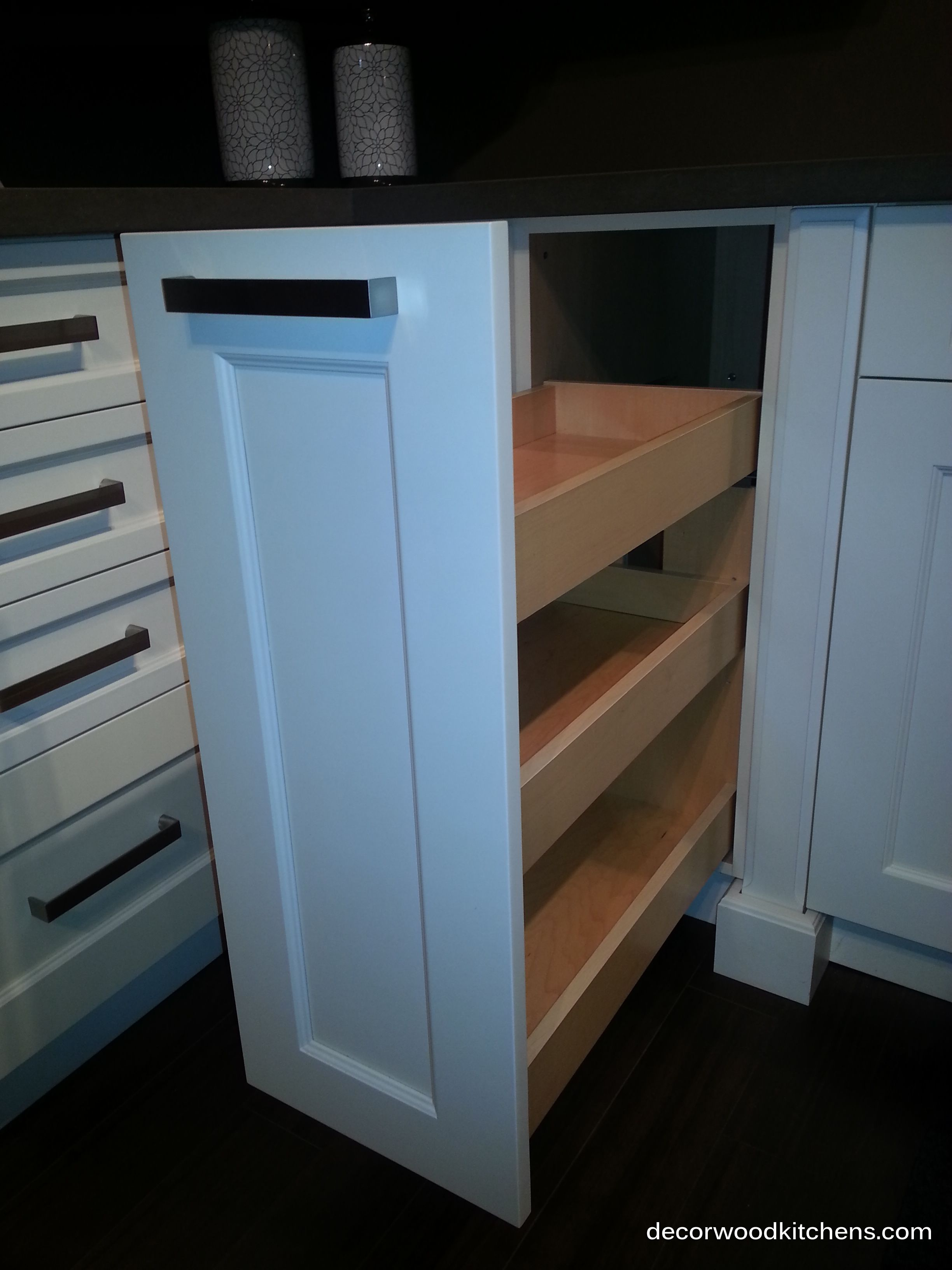 Pull out spice drawer. Middle shelf is adjustable to allow for ...