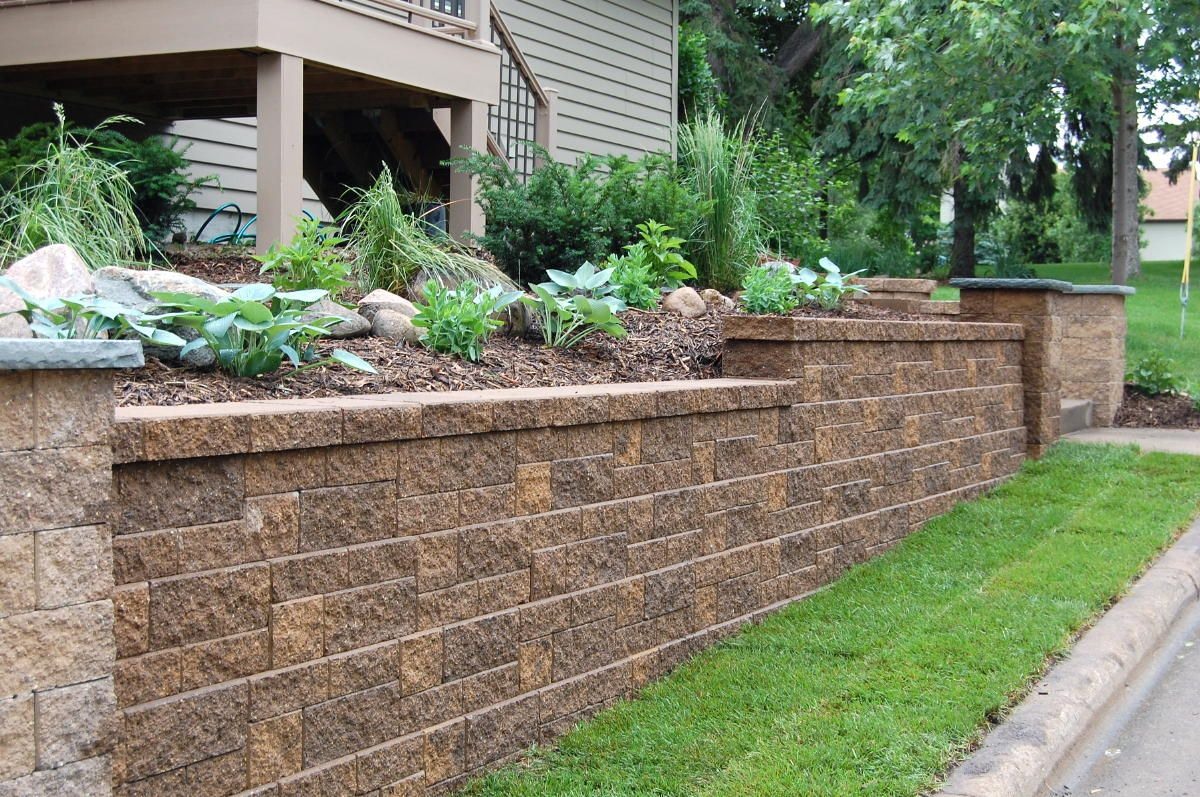 Block retaining walls hold soil or backfill and help for Concrete block walls design