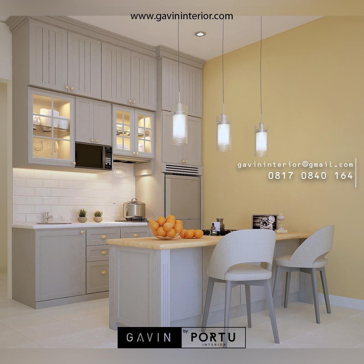 Kitchen set kabinet kulkas full plafon dengan meja island semi klasik untuk klien di bintaro