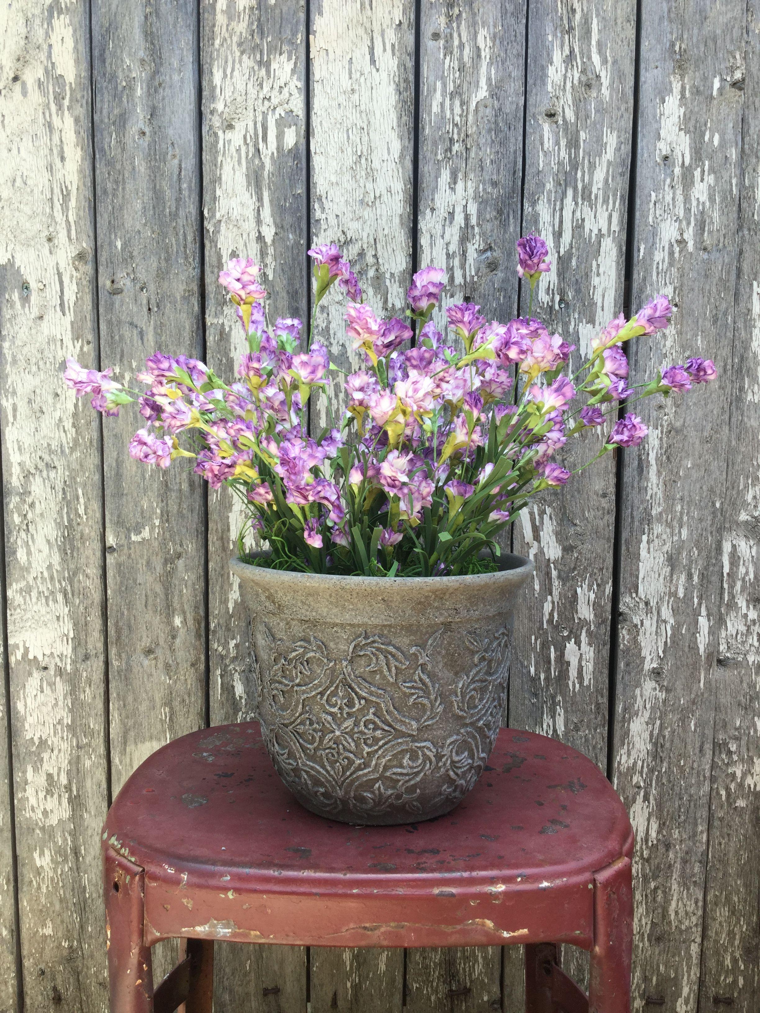 Flower arrangement with purple flowers by mjl flower