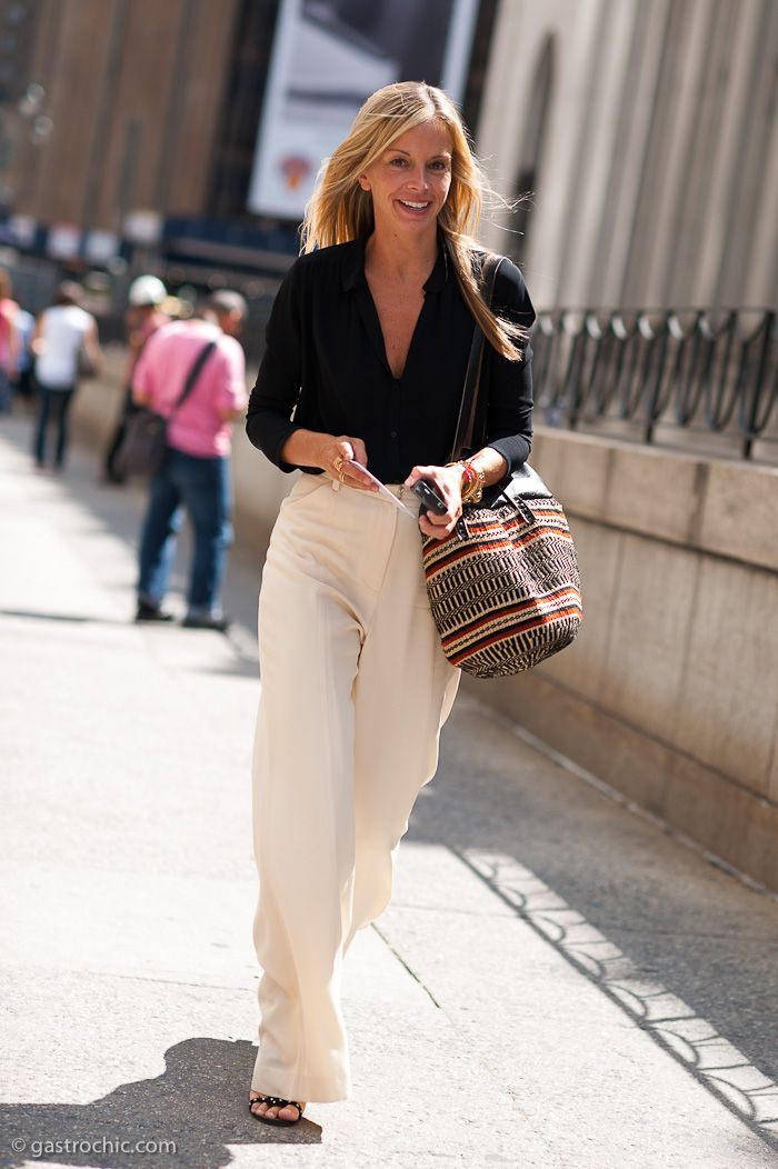 c57693780e9 City chic  Loose high-waisted cream wide-leg trousers and a buttoned down  black blouse