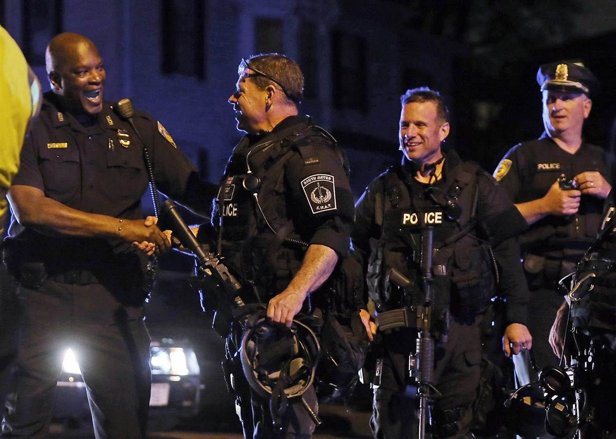 hPolice officers and SWAT team members celebrate after the ...