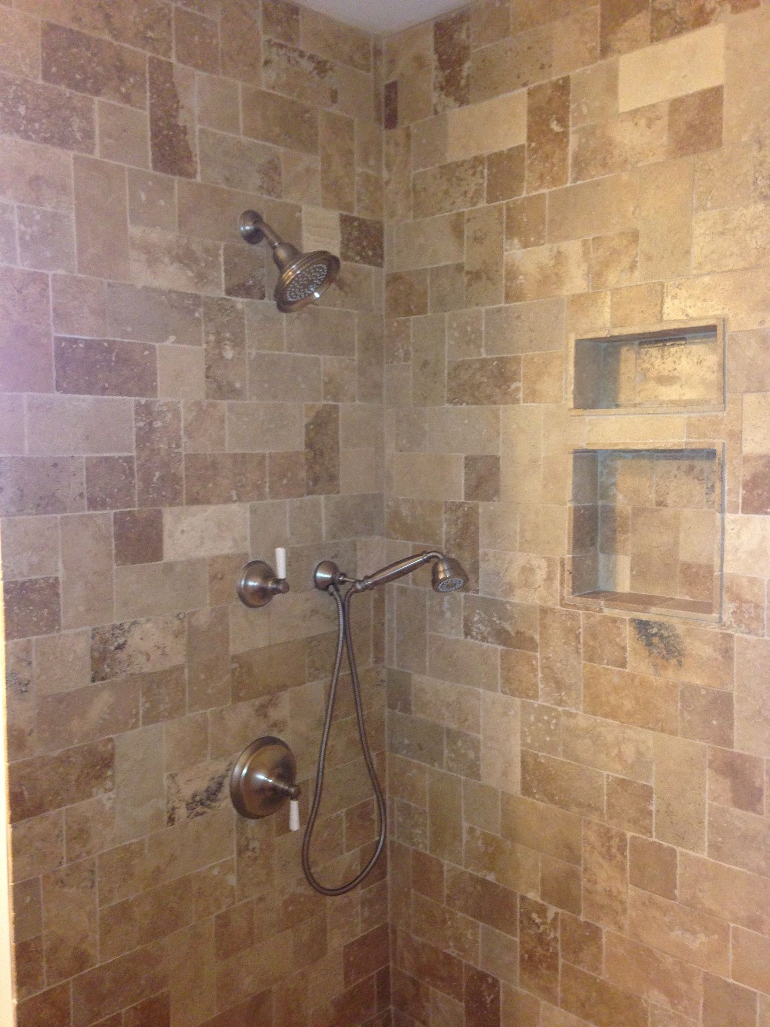 Earthstone Travertine shower in a Tuscany pattern layout