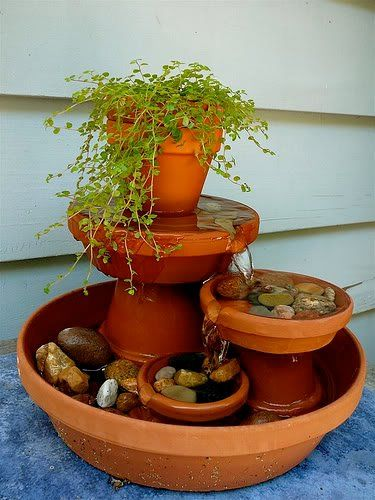 clay pots and saucer water feature