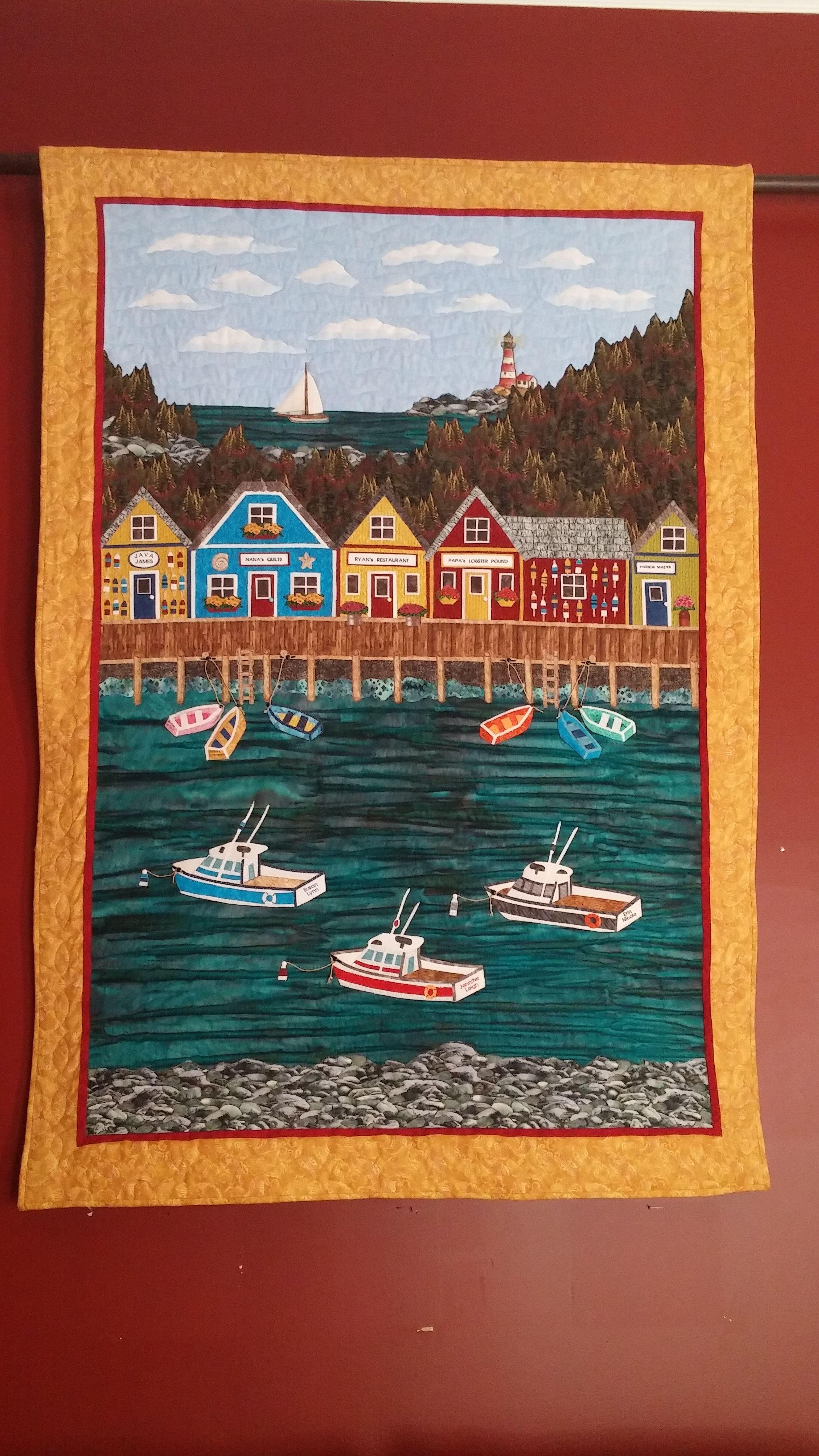 Maine harbor scene landscape quilt.  Boats, Water, Shops, Lighthouse