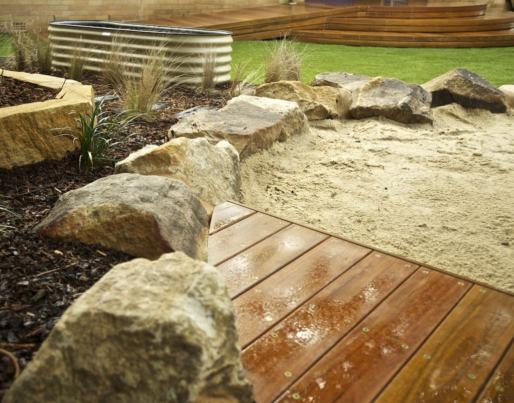 Wood decking provides a clear sitting area or a stage for ...
