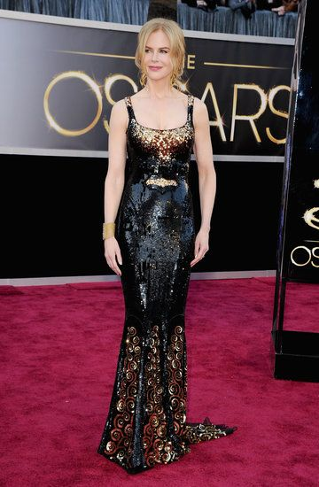 Nicole Kidman Sparkles in Black and Gold at the Oscars: Nicole Kidman on the red carpet at the Oscars 2013.
