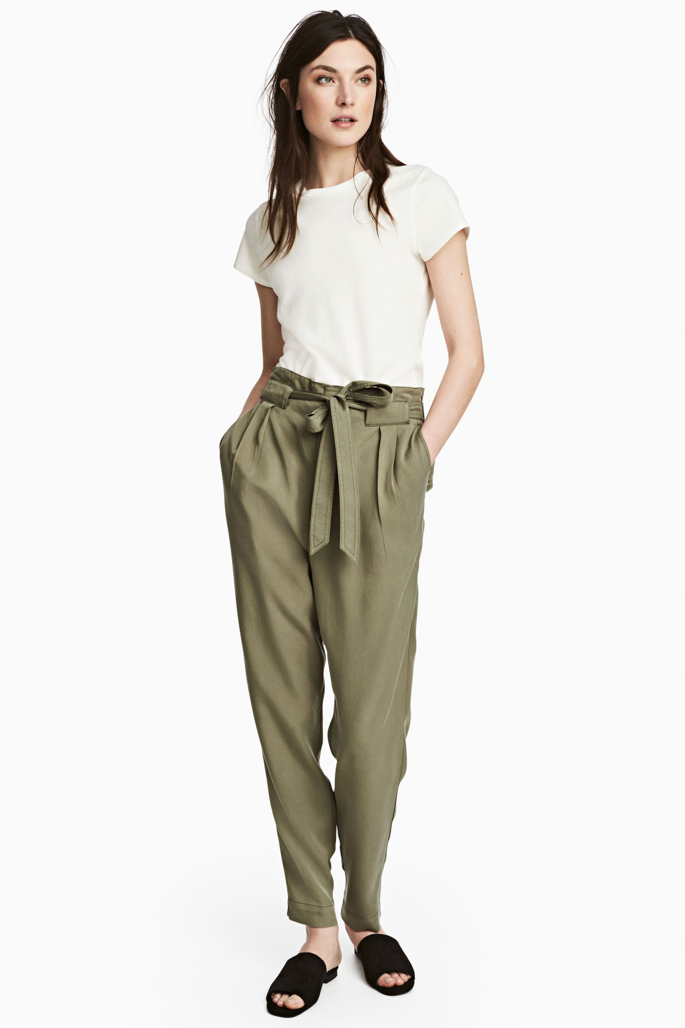 Olive paper bag waist pants trousers, white t-shirt, black slide sandals 23146d909f0