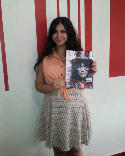 One of our readers with her autographed copy of our June issue. SLASH signed it!