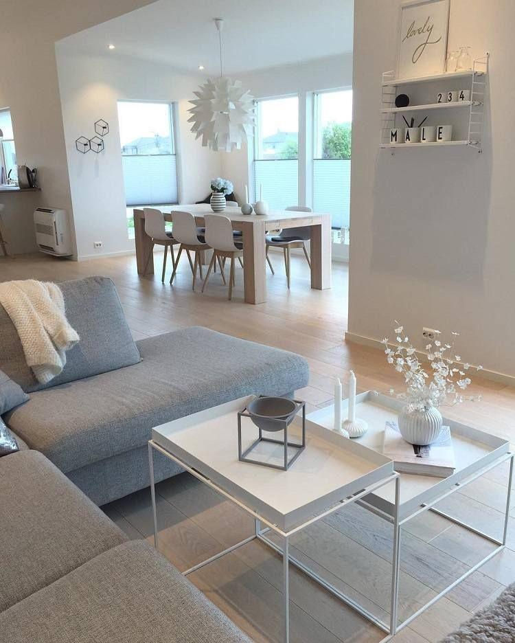 Photo of Ein weiß graues Wohnzimmer lehnte es ab sich in raffinierte Atmosphären zu verabschieden