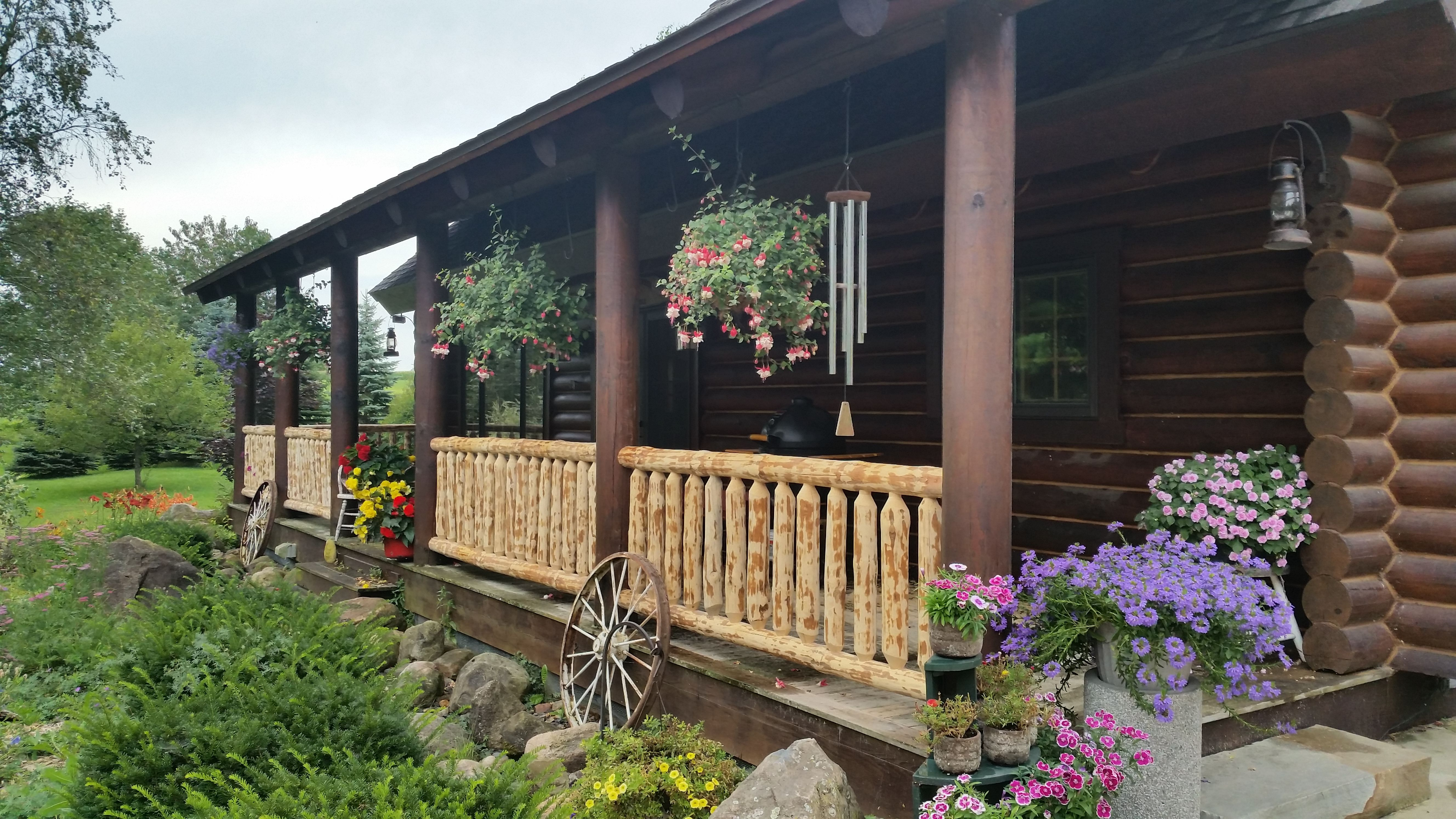 Meadow Valley Log Home With Horizontal Railing