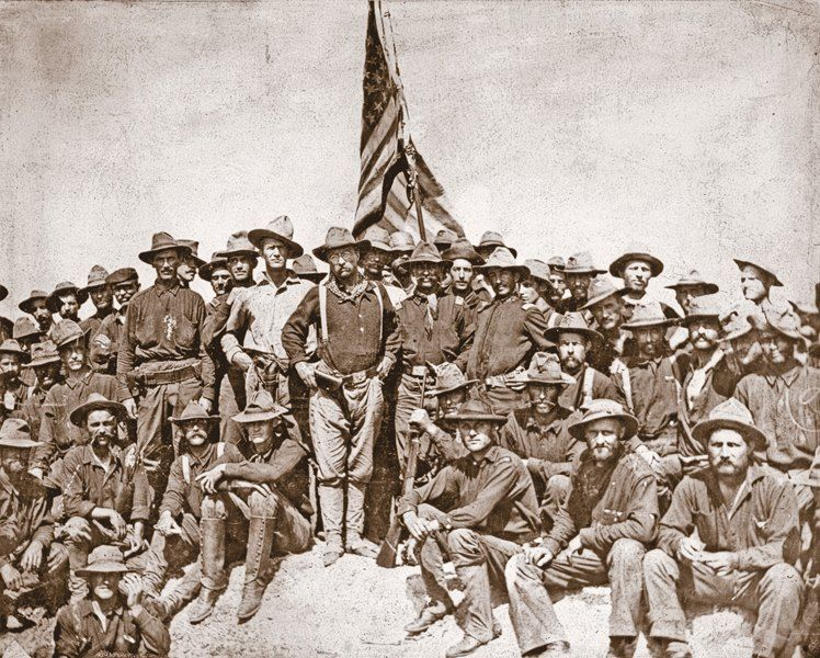 Teddy Roosevelt is shown (center) with his Rough Riders at the top of the hill they captured during the decisive Battle of San Juan