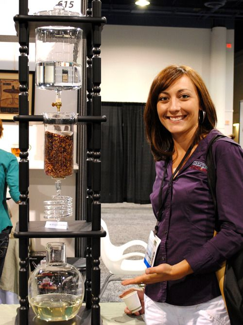 Sarah displays the cold-brew iced tea maker from Northwest Glass Designs.