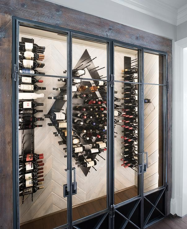 Contemporary Wine Room Features A Wood Herringbone Wall Fitted With Modern Vertical Wine Racks F Contemporary Wine Room Modern Wine Rack Wall Mounted Wine Rack