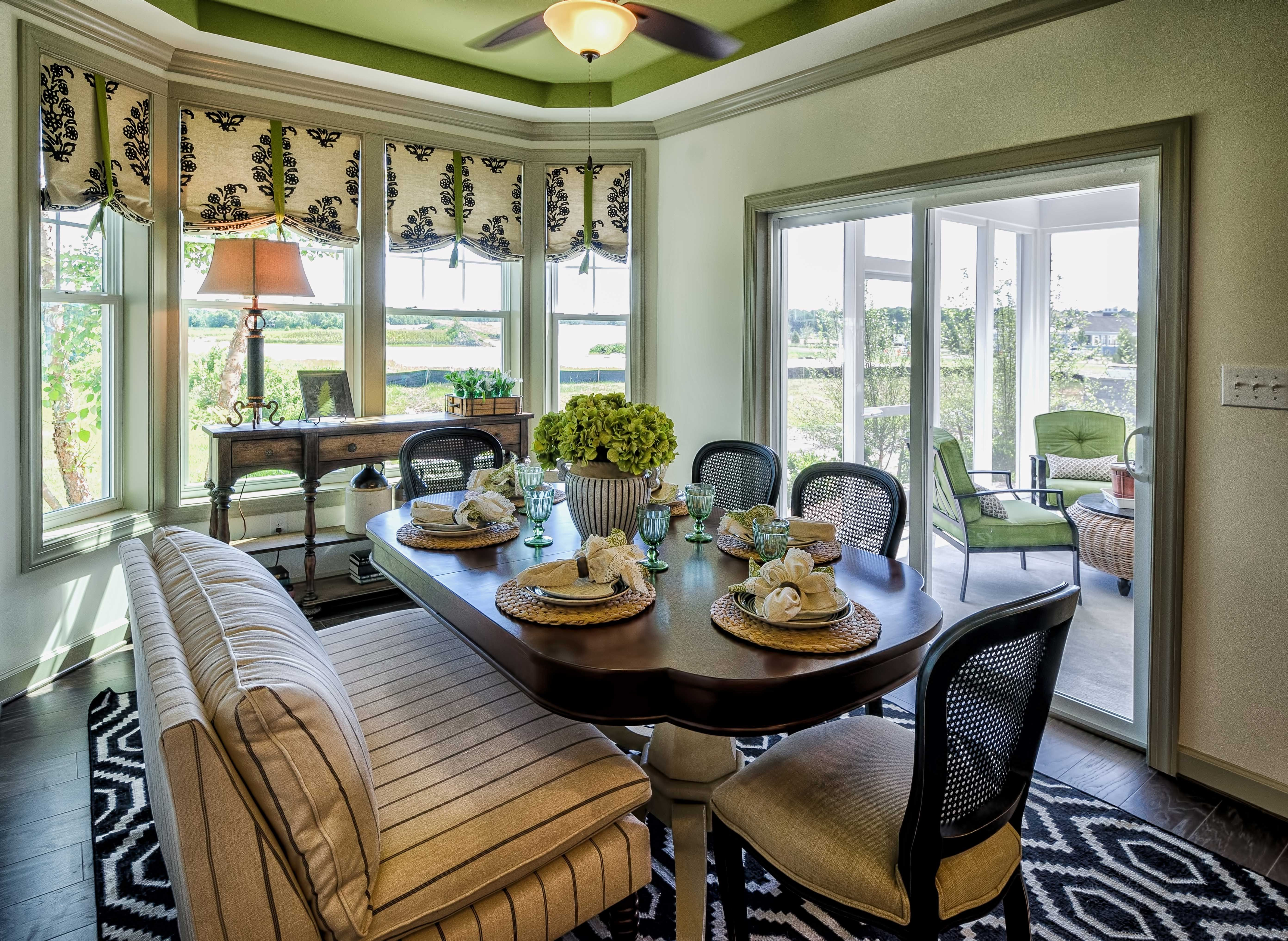 dining area of the sea isle ranch model home by christopher