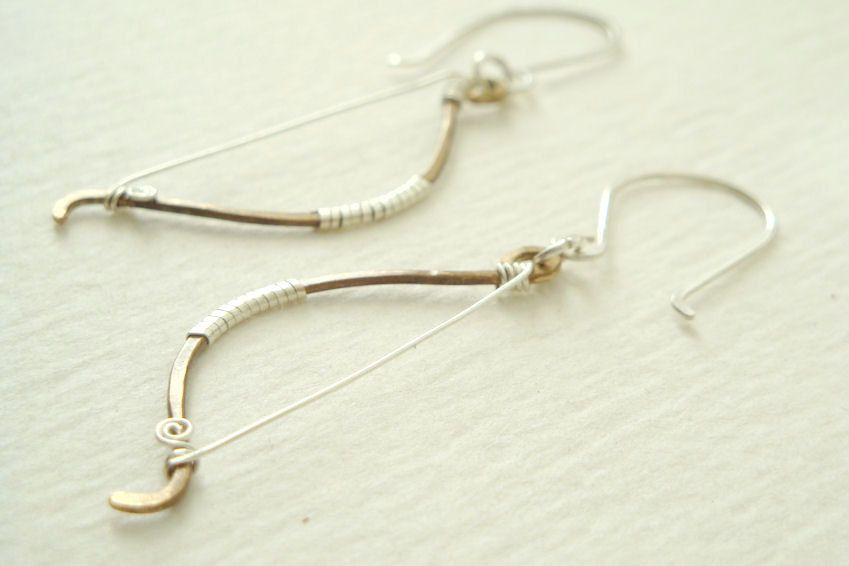 Rustic archery bow earrings - Elven fantasy hunting weapon in antiqued brass and sterling silver - made to order. $27.00, via Etsy.