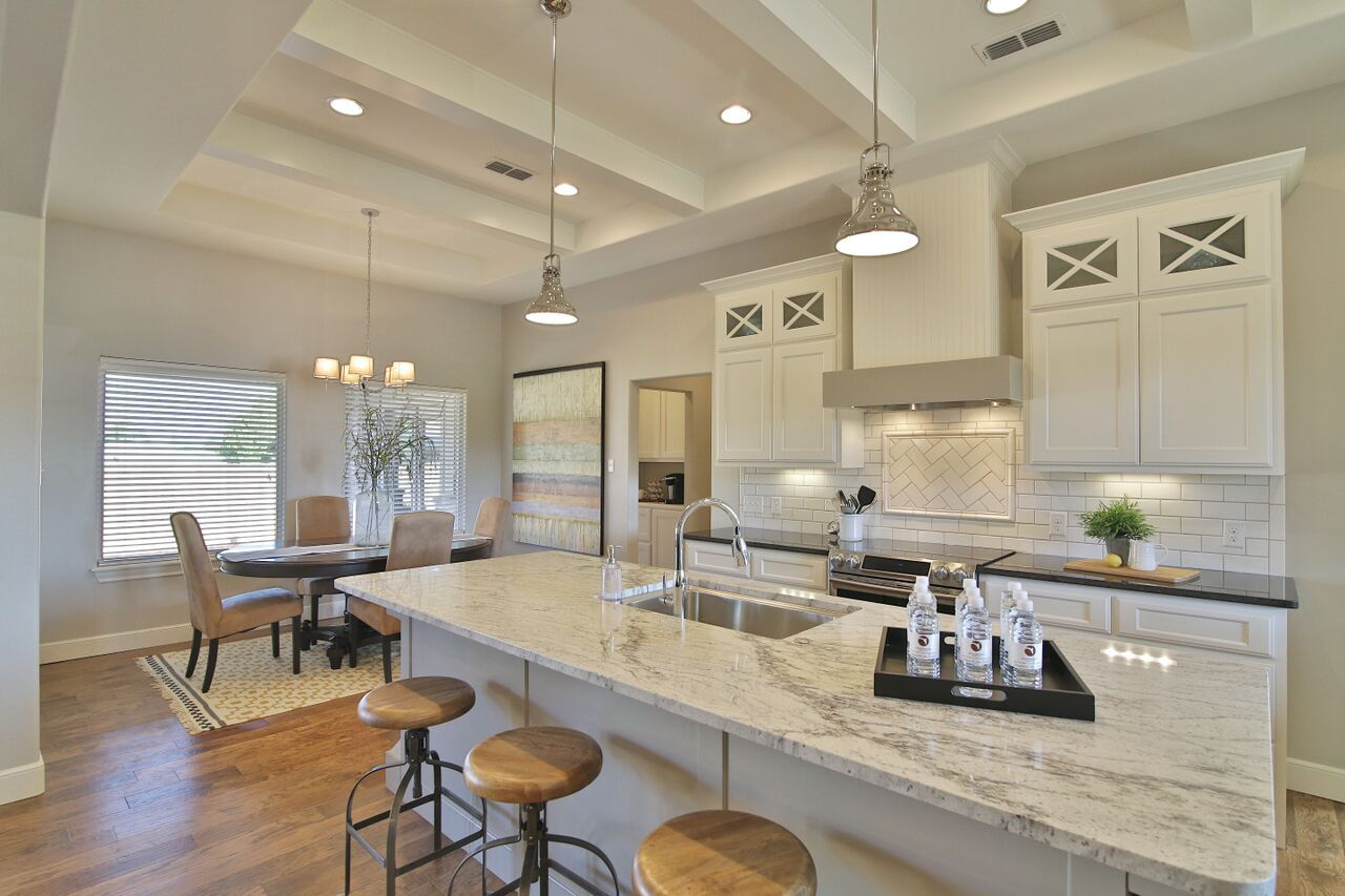 Kitchen and Dining by Stonebridge Design + Build