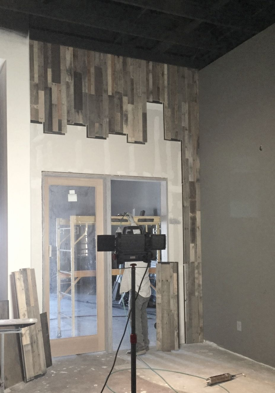 Vertical Installation Of Our Prefabricated Pallet Wood Wall