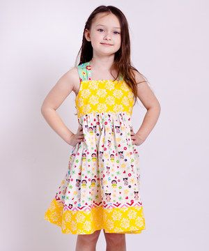 As bright and bold as a butterfly, this cotton frock is full of color and cheer. Featuring adjustable knot ties and a pretty floral trim, it's all ready to fasten daisy chains in a flower garden.