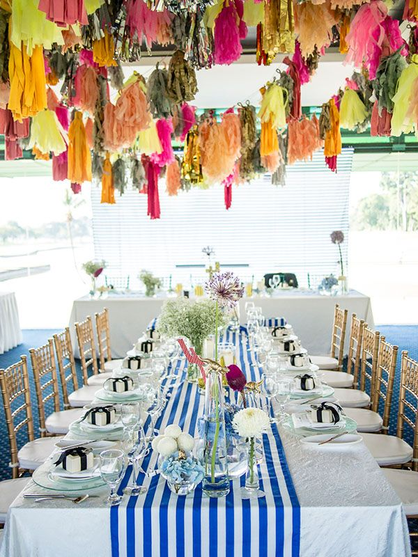 Wedding styling and tiffany chairs wonderland styles 53 haji colorful wedding table decor filled with tassels stripes and dinosaur figurines junglespirit Images