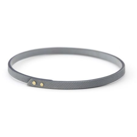 Silver and gold riveted bangle by Kendra Renee Jewelry