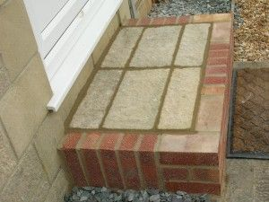 Front door step in brick and stone