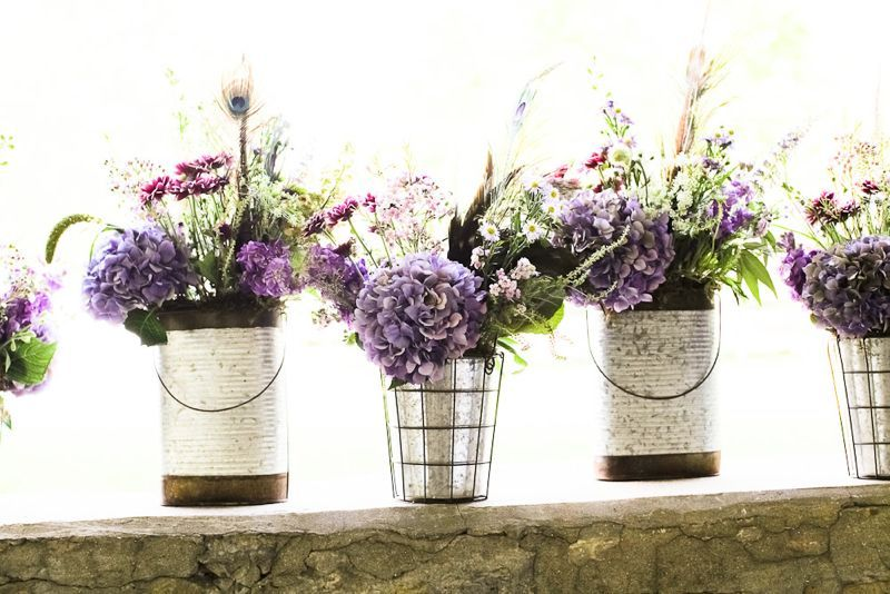 galvanized containers with purple flowers