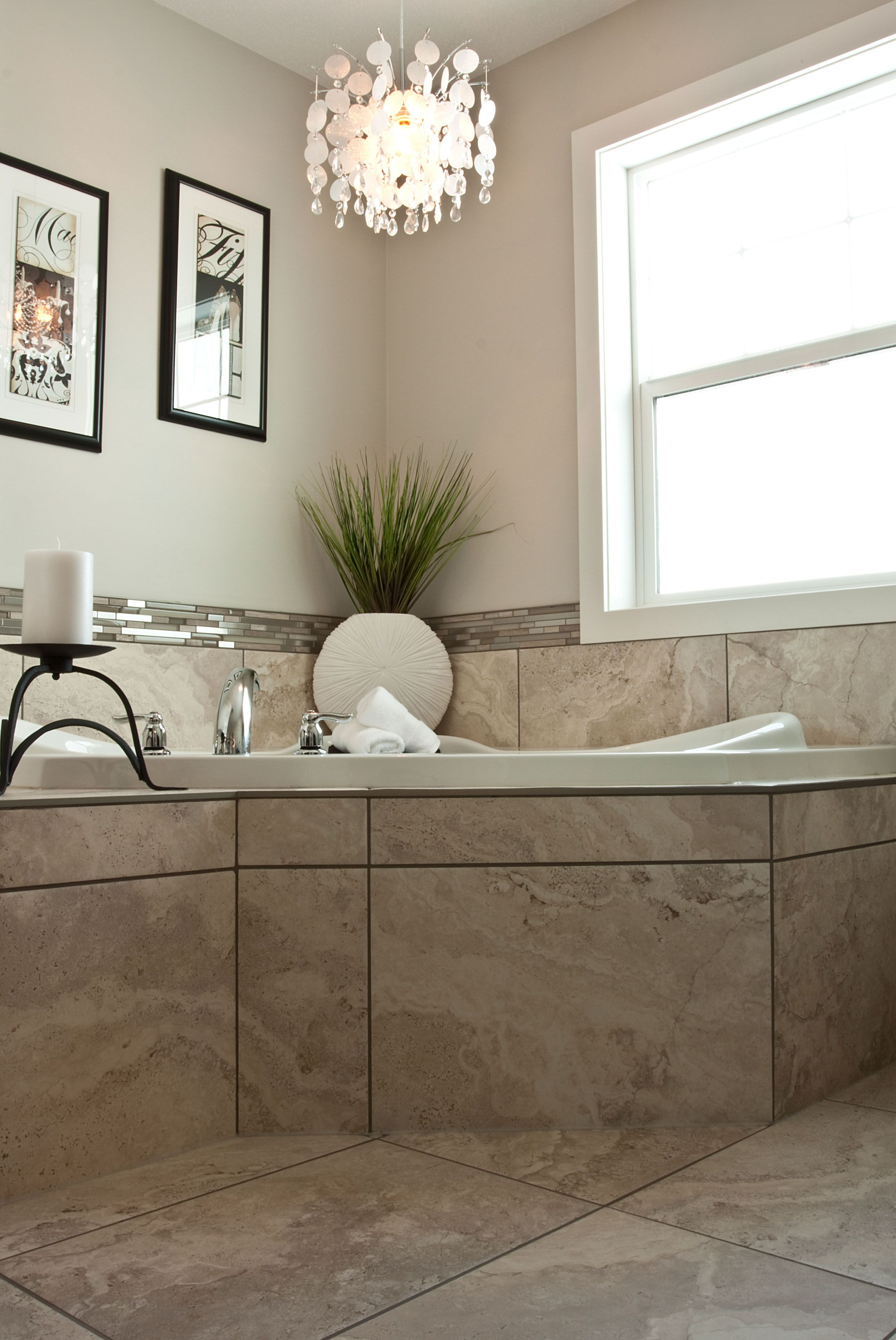 Large format tile surround a soaker tub in the bright and airy ...