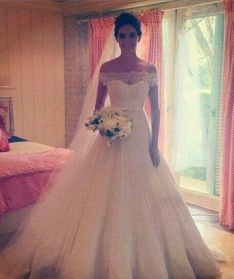 beautiful dress! love the lace over the sweet heart neckline