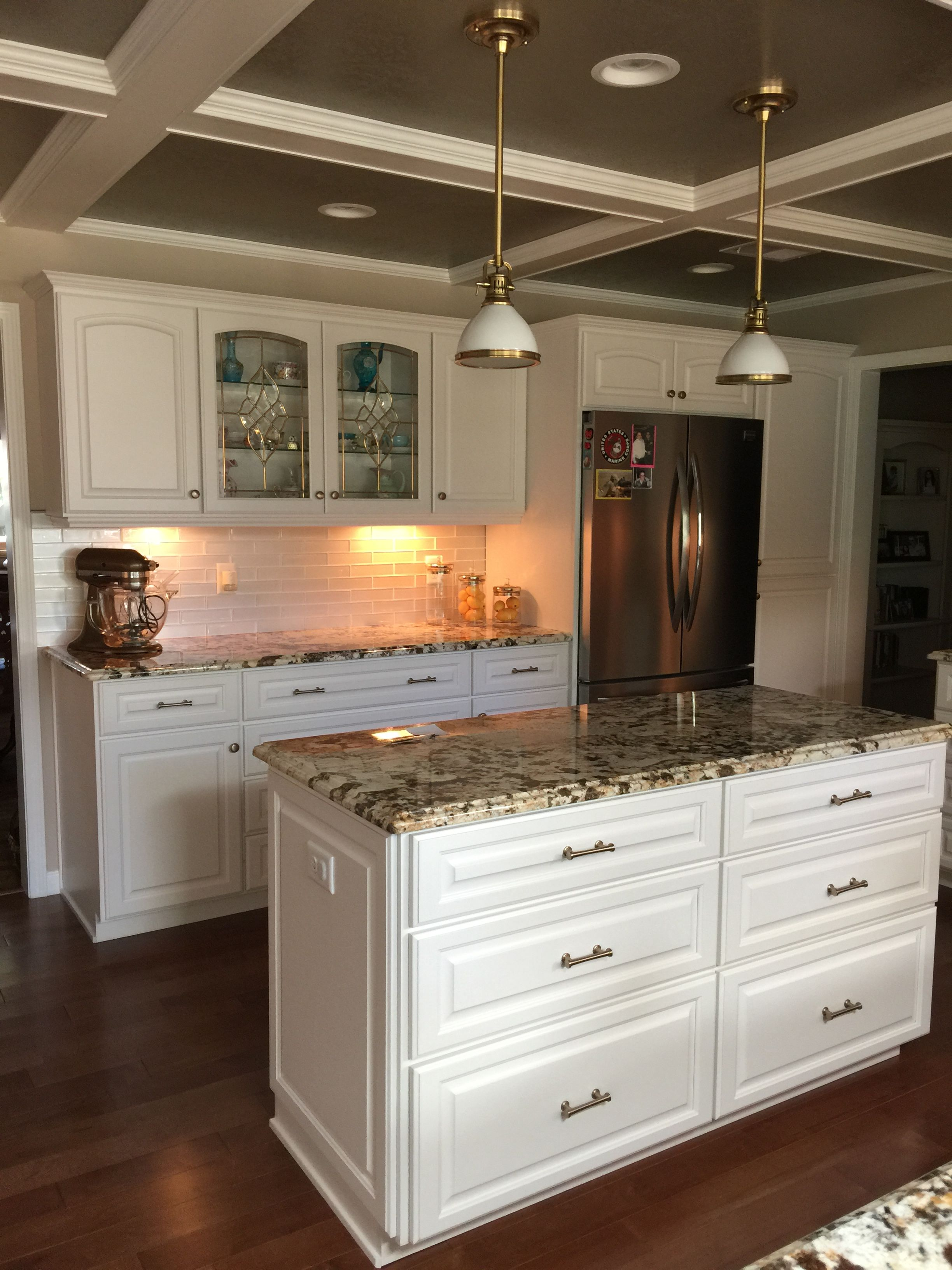 Kitchen with off white granite counters and