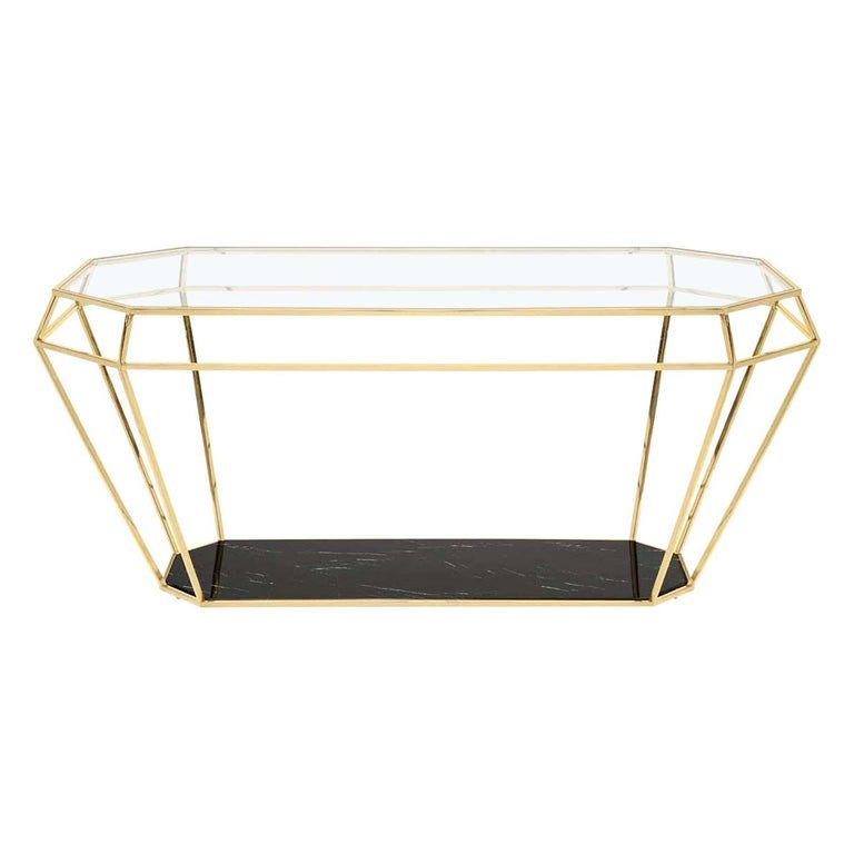 Table Talisma marble with metalstructure in gold finish, with black marble tops.Also available with metal structure in nickel finishwith black marble tops.