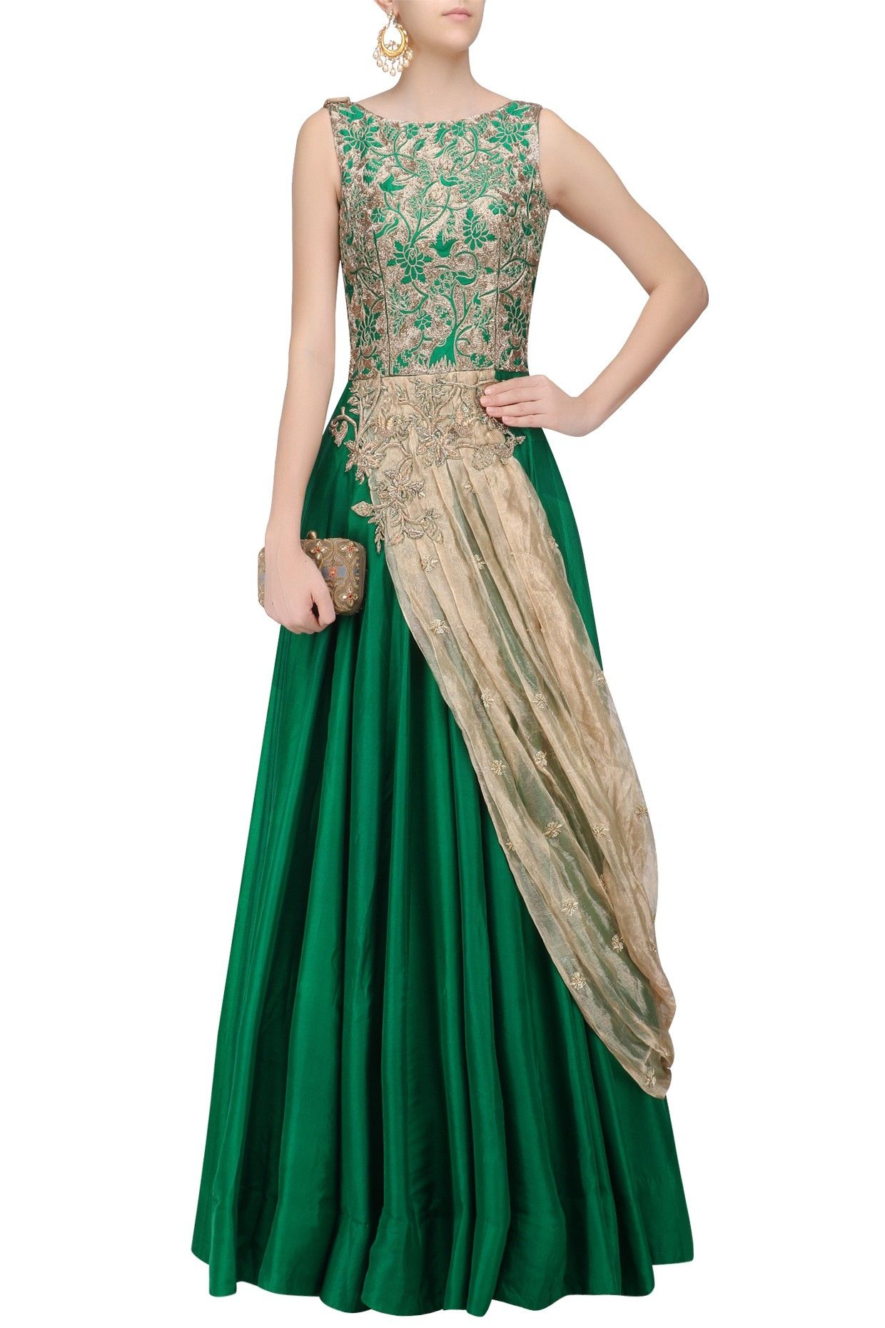 Description This set features a green flared gown in silk base with floral zari embroidery on the fornt bodice and extended floral cutwork detailing around the waist. It has gold organza drape dupatta attached with floral bootis scattered all over. FIT: Cut for relaxed fit. COMPOSITION: Silk, organza.