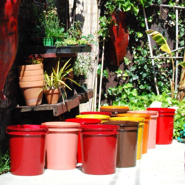 spray painted 5 gallon buckets garden pots, works best