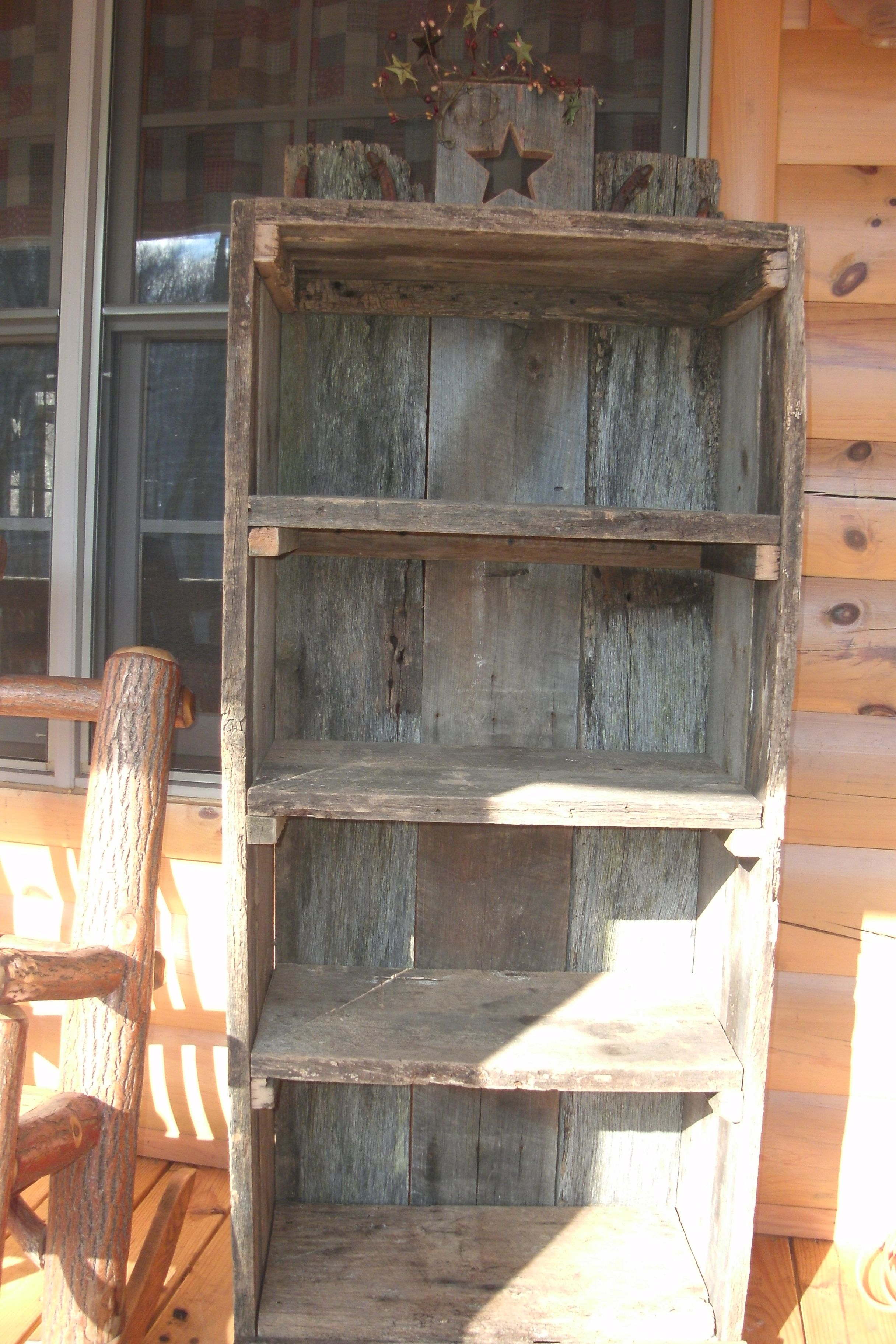 Primitive hand made barnwood bookcase. Top shelf accented with star ...
