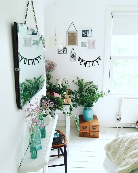Lovely White Room With Decorative Turquoise Glass Bottles With
